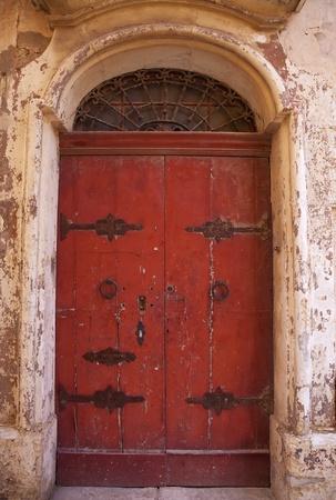 Old red wooden door in  European town  photo