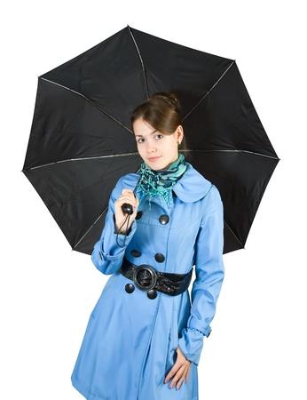 Beautiful young woman wearing blue coat   holding black umbrella, isolated on white background. Stock Photo - 8524036