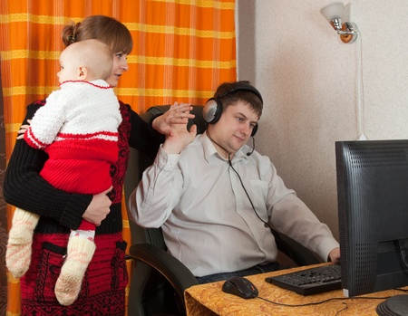 mother and daughter disturbs  working father at home Stock Photo - 8524203