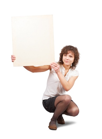 girl holds blank canvas. It is isolated on a white background  photo