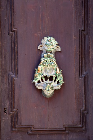 Vintage  brass metal door knocker in european town Stock Photo - 8524240