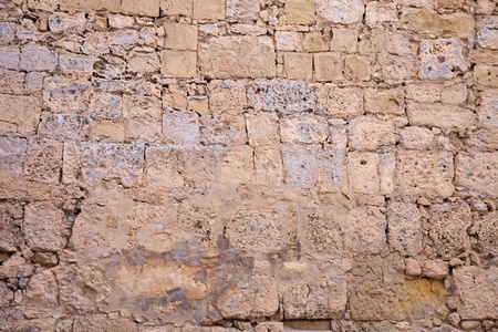 sandstone: Ancient stone wall texture.  Walls of times of knights. Malta