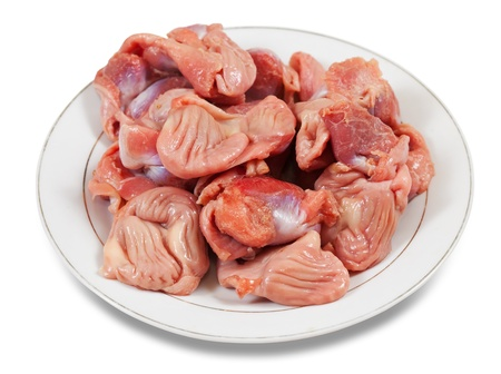 gizzard: Raw fresh chicken gizzard in  white plate. Isolated on white