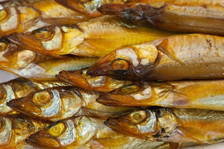 background of  golden  smoke-dried  fish close up  photo