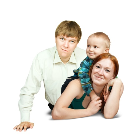 Happy family of 3 people lying over white  photo