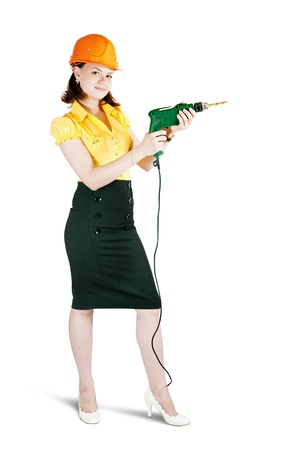 beauty girl in hard hat with drill. Isolated over white Stock Photo - 8590831