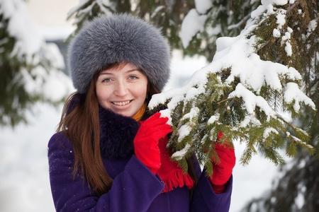 Portrait of  woman near fir-tree in winter Stock Photo - 8591802