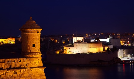 Vedette tower over Grand Harbour at Valletta fortress in night. Malta photo