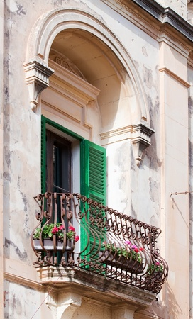 window with green shutters on old wall at mediterranean town Stock Photo - 8594680
