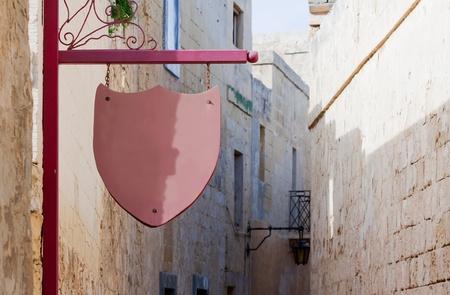 old wooden signboard on   old mediterranean street Stock Photo - 8594681