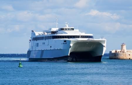 seabus: Big catamaran ferry going into  Grand Harbour (Malta) Stock Photo