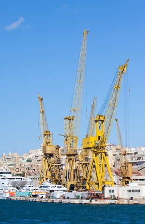 Cranes in  dry dock at Grand harbour (Malta) photo