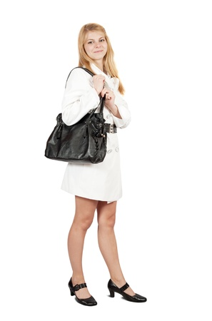 Pretty  girl in cloak with purse. Isolated over white Stock Photo