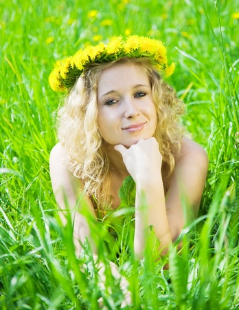 Blonde girl in chaplet lying at meadow Stock Photo - 8631122