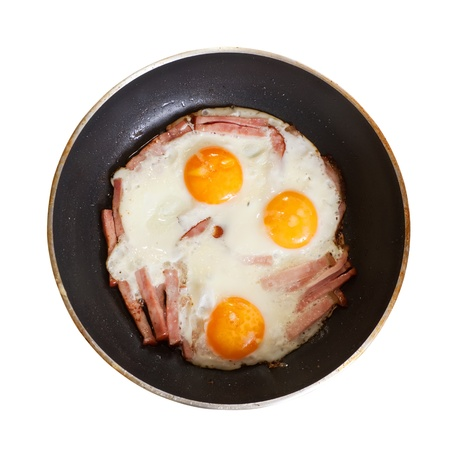 tast:   fried eggs with bacon skillet. Isolated over white Stock Photo