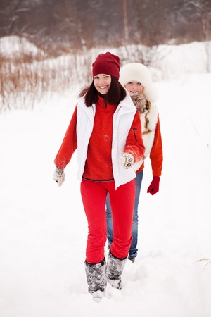 two sporty girls runs at winter park photo