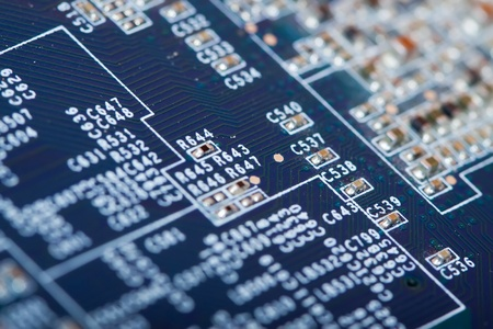view of computer printed circuit as background. Shallow DOF Stock Photo - 8631239