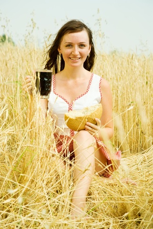 Girl  with quass and bread  at wheat field Stock Photo - 8631235
