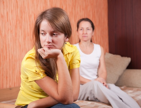 teenager daughter and mother after quarrel at home Stock Photo - 8670132