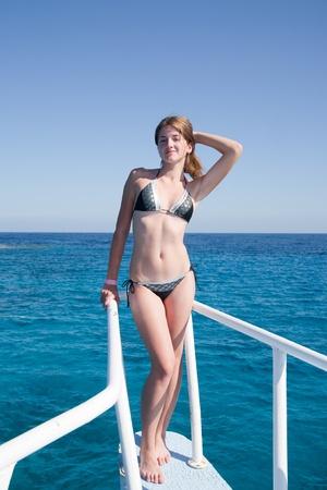 beauty girl in enjoying sitting on the ship Reklamní fotografie
