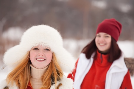 Two sporty girls workouts at winter park photo