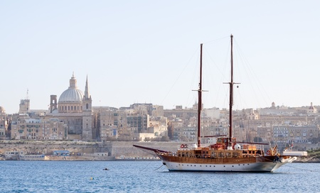 malta: Vintage ship docked in creek against old town (Valletta, Malta)