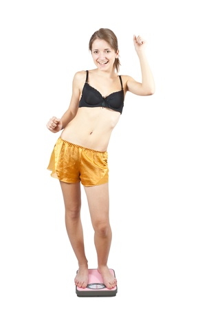 girl in shorts: Girl measuring waist with tape measure. Isolated on white