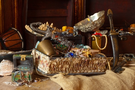 Old treasure chests with vintage gems and jewellery photo