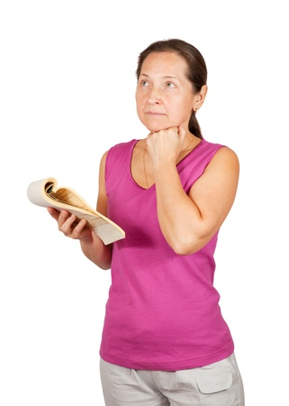 lamentable: thoughtful mature woman with notebook over white background Stock Photo