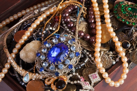 Closeup of full treasure chest with jewellery photo