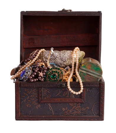 wooden treasure trunk with jewellery, isolated over white background photo
