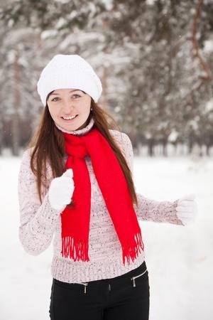 Yuong sporty woman runs at winter park photo