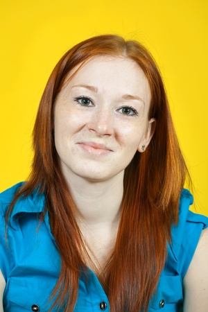 carroty: Portrait of red hair young woman over yellow