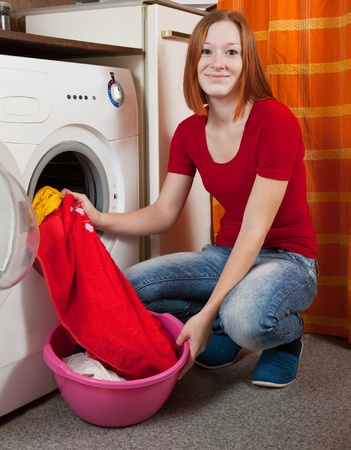 Young woman doing laundry at her home Stock Photo - 8769711