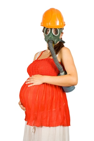 9 months pregnant woman in hardhat and gas-mask over white photo