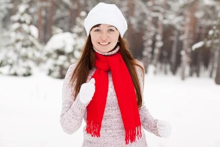Young sporty woman runs at winter park photo