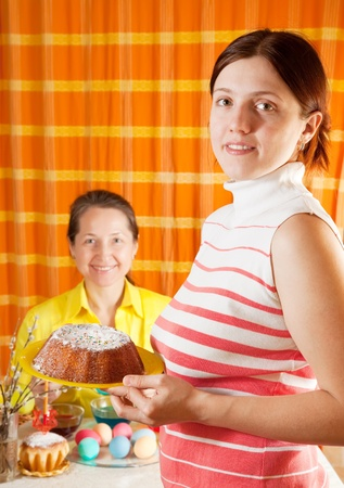 Two women are preparing for  Easter holiday in home photo
