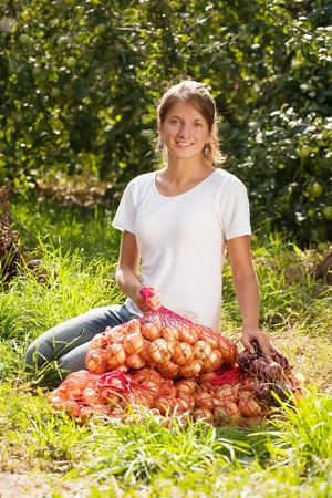 young girl with harvested onion in field Stock Photo - 8771888
