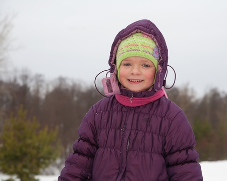 wintery: child in  winter jacket against wintery nature