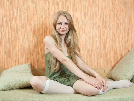 Portrait of long-haired girl in home interior photo