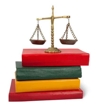 antique scales:   justice concept.  Scales of justice atop legal books. Isolated  Stock Photo