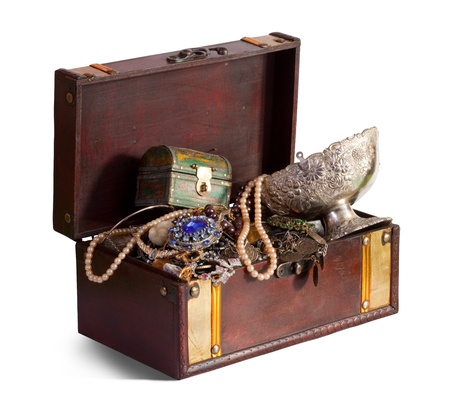 Old treasure chest with vintage gems and jewellery photo