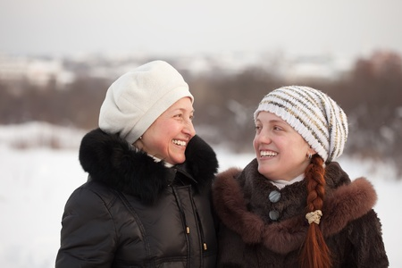 douther: Portrait of two happy women in winter park