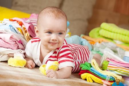 babygro: Happy baby girl with heap of babys wear