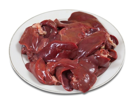 offal: Raw fresh chicken liver in the white plate. Isolated on white