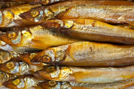 smoked: background of  golden  smoke-dried  fish close up