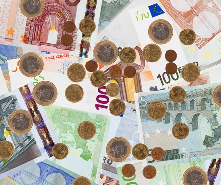 Background of many euro banknotes and coins photo