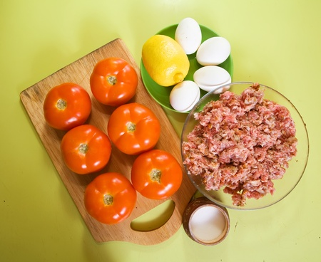 farce: food products for farci tomato   on cook-table. See in series stages of cooking of farci tomato