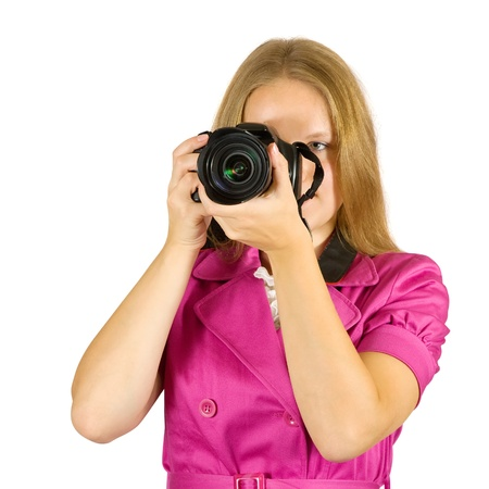 photographer girl with camera. Isolated over white background