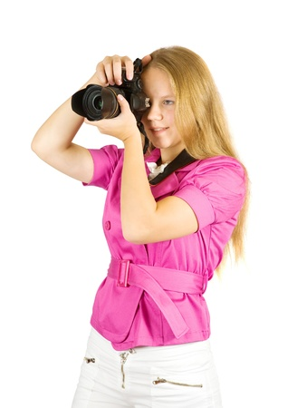 Young photographer girl, isolated over white background photo